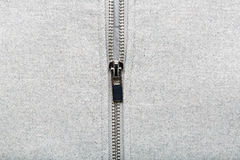 Silver zip on woolen fabric Royalty Free Stock Images