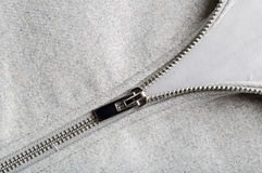 Silver zip on woolen fabric Stock Image