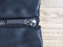 Silver zipper in black leather Royalty Free Stock Photography