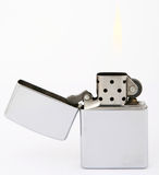 Silver zippo lighter. Silver metal zippo lighter for smokers, close-up, macro, copy space, isolated on white Stock Photography