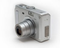 Silver zoom camera. Silver point and shoot zoom camera on white Royalty Free Stock Photos