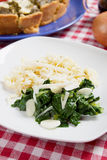 Silverbeet with noodles, garlic and grated cheese Stock Photo