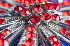 Silverbrosch med röda stenar Fotografering för Bildbyråer