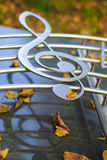 Silvered clef on a staff Royalty Free Stock Photography