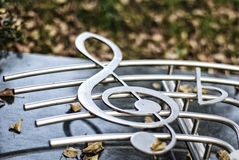 Silvered clef on a staff Royalty Free Stock Images