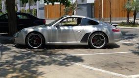 Silverfärg Porsche Carrera S Fotografering för Bildbyråer