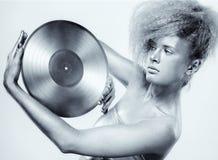 Silverflicka med vinyl arkivfoto