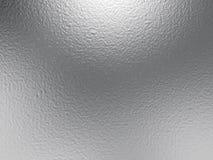 Silverfoliebakgrund med ljusa reflexioner Royaltyfria Bilder