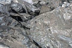Silverfoliebakgrund med skrynklig yttersida Royaltyfria Bilder