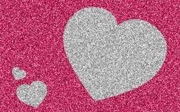 Silvergiltterhjärta på rosa färger blänker Arkivbild