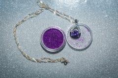 Silverhänge med purpurfärgad Zircon Royaltyfria Bilder