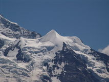 The Silverhorn, Eternal Snow. A view of the Silverhorn mountain, near the Jungfrau. This peak is covered with snow 12 months a year Stock Images