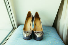 Silvering bride shoes on wedding day on blue pillow Royalty Free Stock Photos