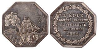 Silvers token. Paris marine insurance company 'Eol'. France, Napoleon III, 1855, isolated on white Royalty Free Stock Photo