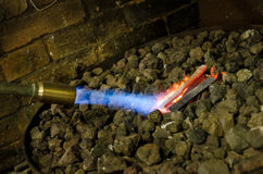 Blow torch and piece of metal Royalty Free Stock Photography