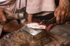 Silversmith at workshop creating silver jewlery. Silversmith at his workshop creating silver jewlery from raw silver bars. Bundi, Rajasthan - India royalty free stock images