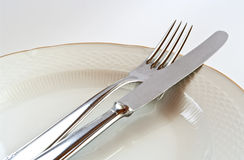 Silverware. On a plate on white Stock Photos