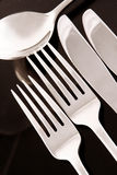 Silverware on Black. Knives, Forks and Spoon, reflected on black surface stock photo