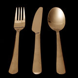 Silverware on Black. Isolated Fork, Knife and Spoon on black background Royalty Free Stock Photo