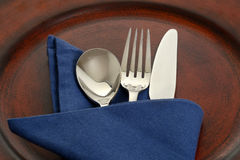 Silverware in blue napkin Royalty Free Stock Photography