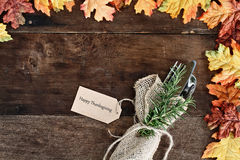 Silverware and Card over Wooden Background Stock Photo