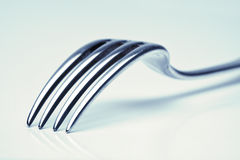 Silverware - closeup of a fork Stock Image