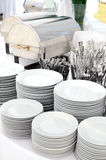 Silverware and dishware. Stacks silverware and dishware for a buffet stock photos