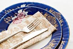 Silverware on fine porcelain Royalty Free Stock Photos
