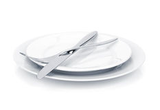 Silverware or flatware set of fork and knife over plates Stock Photography