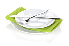 Silverware or flatware set of fork and knife over plates Royalty Free Stock Photos