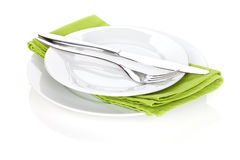 Silverware or flatware set of fork and knife over plates Royalty Free Stock Photography