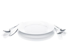 Silverware or flatware set of fork, spoon, knife and plate Stock Image