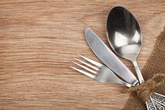 Silverware or flatware set of fork, spoon and knife. On wooden table stock image
