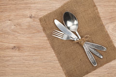 Silverware or flatware set of fork, spoon and knife. On wooden table Royalty Free Stock Photos