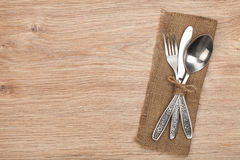 Silverware or flatware set of fork, spoon and knife. On wooden table stock photo