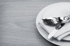 Silverware or flatware set of fork, spoons and knife on plate Stock Photo