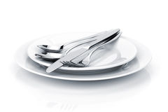 Silverware or flatware set of fork, spoons and knife on plates Stock Image