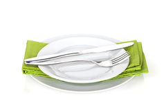 Silverware or flatware set of fork, spoons and knife on plates Royalty Free Stock Image