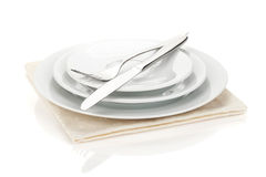 Silverware or flatware set of fork, spoons and knife on plates Stock Photos