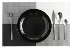 Silverware or flatware set and plates isolated on white. Background stock image