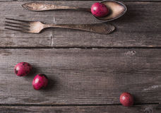 Silverware fork and spoon with easter eggs Stock Images