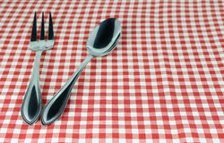 Silverware fork and spoon on tablecloth. For food serving background Stock Photos