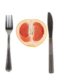 Silverware and grapefruit Stock Images