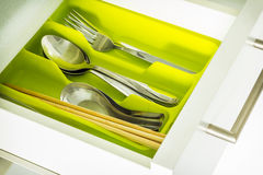 Silverware. In green tray,spoon,fork,chopsticks royalty free stock photography