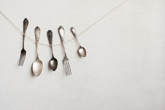 Silverware hangs on the wall Stock Photo