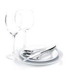 Silverware lub flatware ustawiający nad talerzami i win szkłami fotografia stock