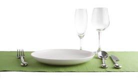 silverware lub flatware ustawiamy i talerze odizolowywający na bielu Zdjęcia Stock