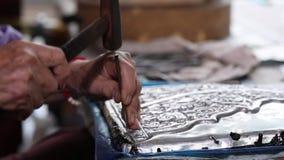 Silverware making. Thai craftman are making silverware. The original of the silver craftsmen at Wua Lai road, Chiang Mai. Thailand