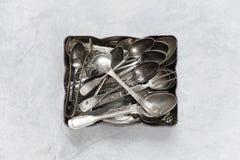 Silverware in a metal tray Stock Photos