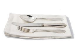 Silverware on napkin Stock Photos